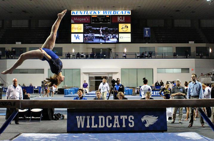 photo of UK gymnast competing on balance beam