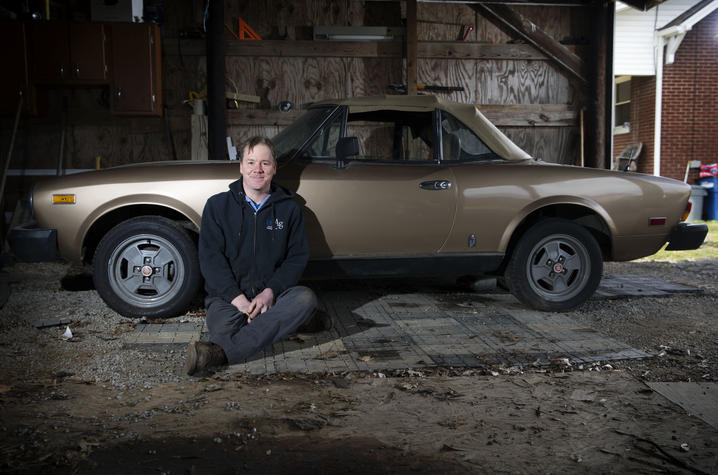 Photo of Gill Heart and Vascular Institute patient Jason Conn with his 1981 Fiat Spyder