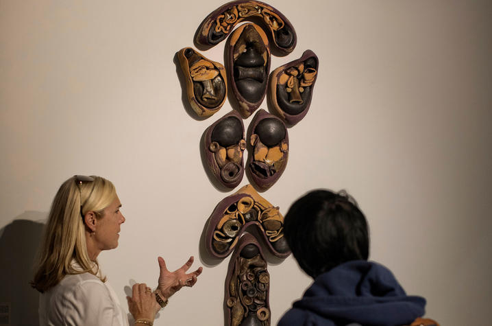 "photo of 2 people with Hunter Stamps sculpture - ""Faculty Series: Vol. I."" Mark Cornelison 