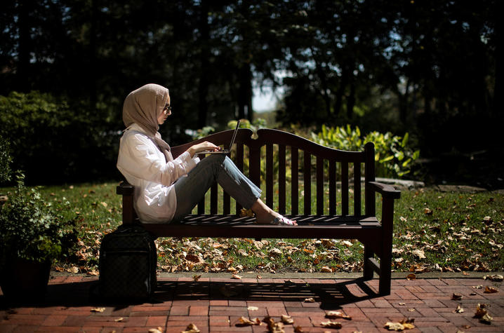 Photo of Student on a Bench