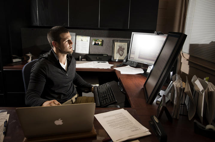 Alex Elswick sitting at his computer working