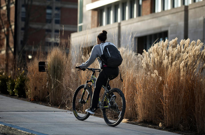 photo of girl on bike