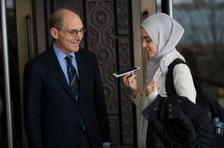 photo of Capilouto and Hadeel Abdallah holding her cellphone