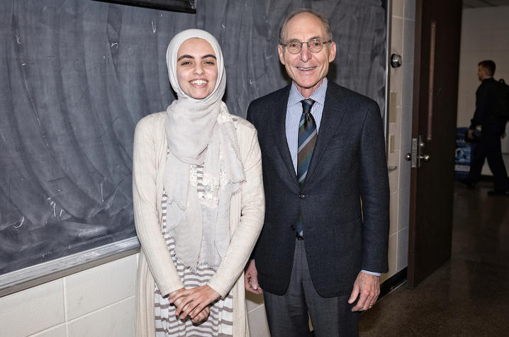 photo of Hadeel Abdallah and Capilouto in front of chalkboard