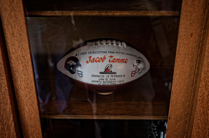 This is a photo of an NFL game ball in Jacob Tamme's office.
