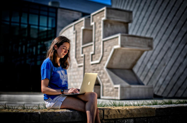 Photo of student in front of student center