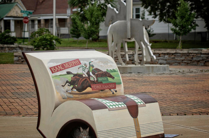 """photo of book bench for """"Isaac Murphy: I Dedicate This Ride"""" by Isaac Murphy sculpture"""