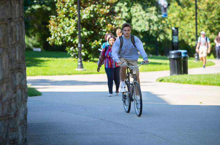 Photo of student riding a bicycle