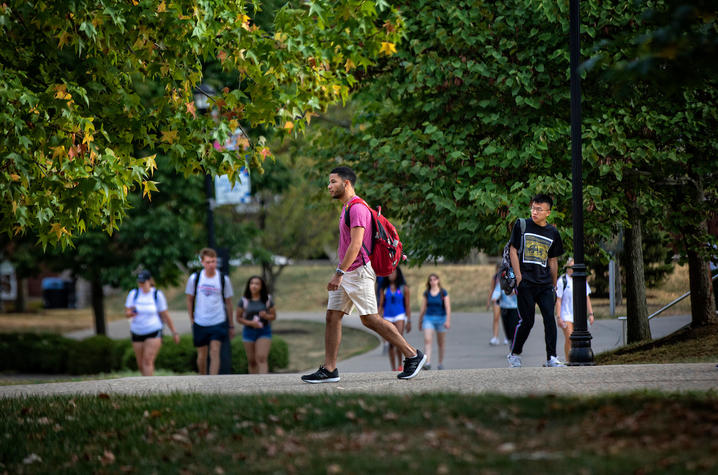 Photo of student walking on campus