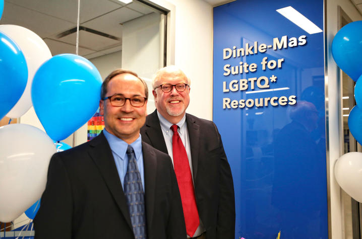 Jim Dinkle (right) and his partner Carlos Mas Rivera celebrate at the Dinkle-Mas Suite for LGBTQ* Resources
