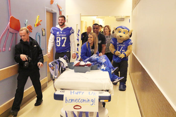 CJ and the cheerleaders made a parade float out of a stretcher
