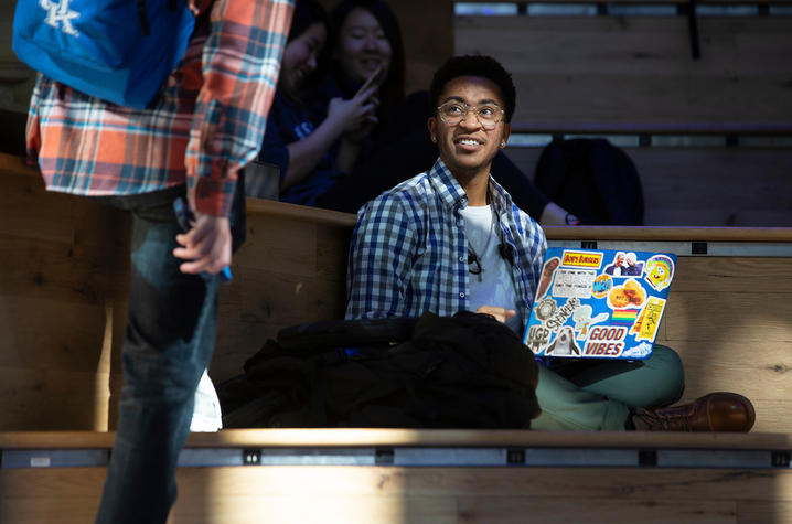 student sitting with a laptop