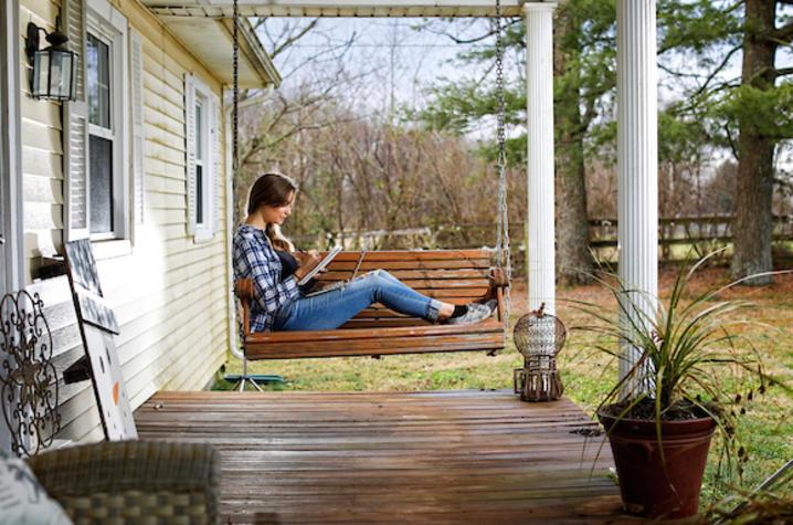 Photo of girl sitting on swing