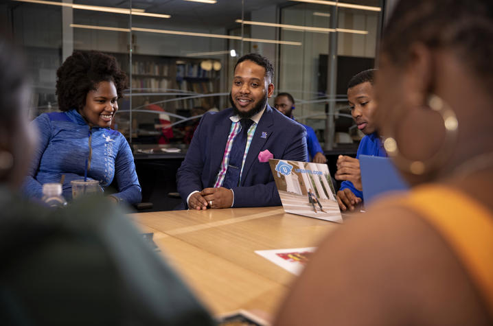 photo of Jason Brooks and students at table in MLK Center