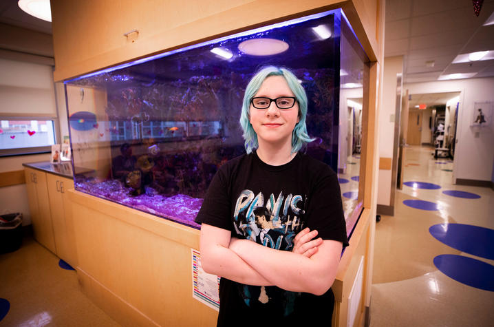 Photo of Bethany Stephens in front of fish tank in DanceBlue clinic