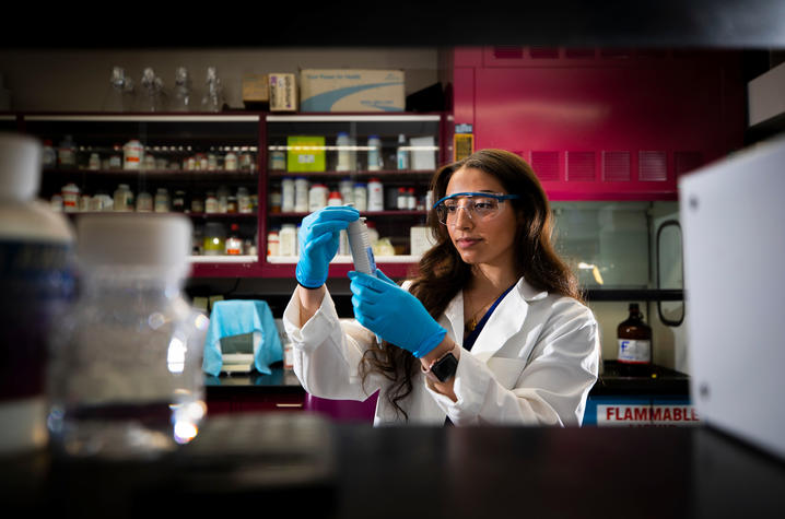Amina Nouri conducts experiments in the lab | Photo by Pete Comparoni