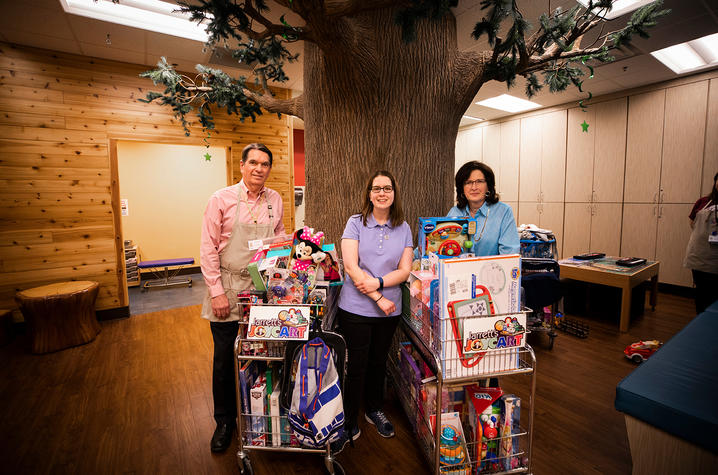 Doug, Claire and Jennifer Mynear with the joy cart