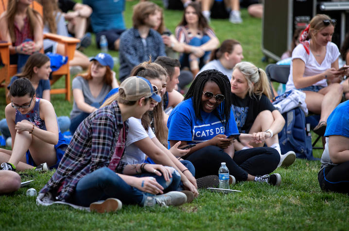 Photo of students sitting together on lawn