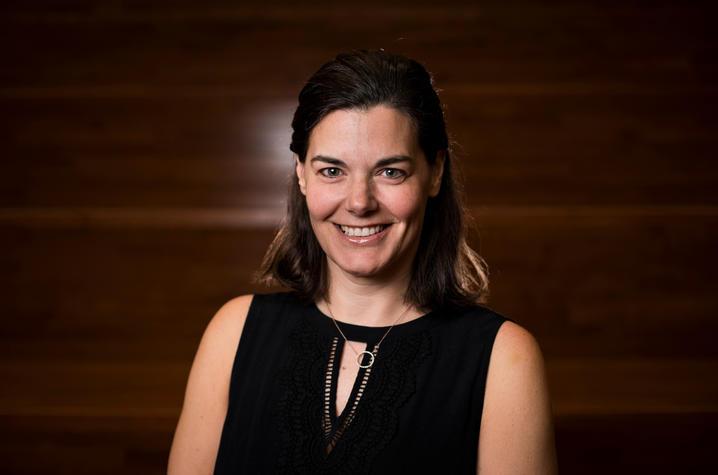Alison Davis portrait against wood backdrop