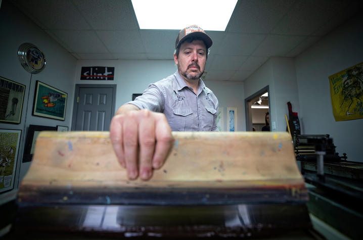 Brian Turner applying ink to print