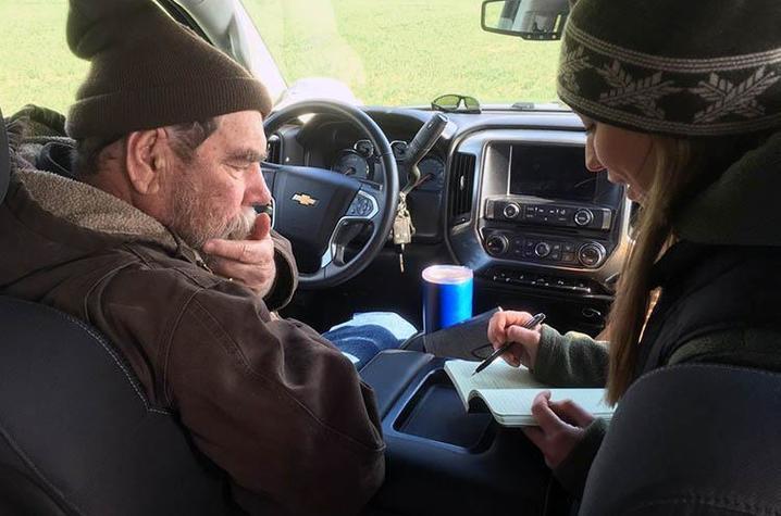 Richard Preston and Hanna Poffenbarger seated in vehicle