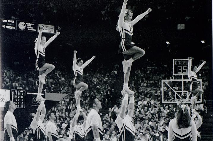 black and white photo of UK Cheerleading during game at Rupp from 2002 Kentuckian