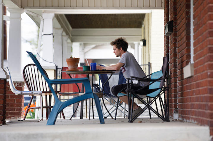 Photo of student working on porch