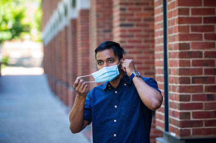 Photo of student putting on mask