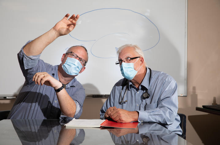Gregory A. Jicha,  left, and Pete Nelson, of Sanders Brown Center on Aging on July 21, 2020. Photo by Mark Cornelison | UKphoto