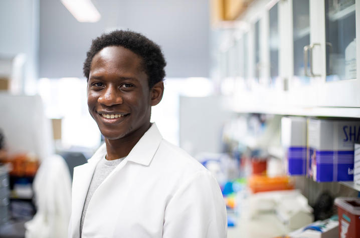 Mirindi Kabangu, a student under Dr. Randal Voss, conducting research in Voss' lab. Photo by Pete Comparoni | UKphoto
