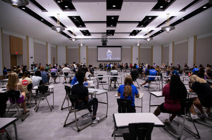 photo of students in large ballroom, physically distanced