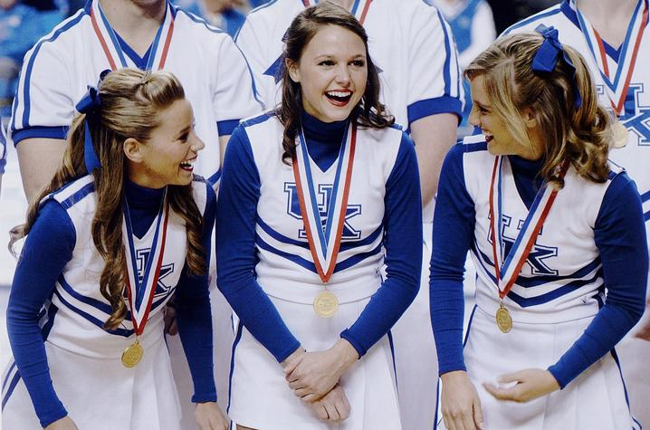 photo of three of UK's cheerleaders with medals at Rupp from 2010 Kentuckian