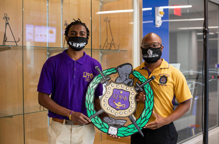 Members of Omega Psi Phi Fraternity, Inc. display their crest.