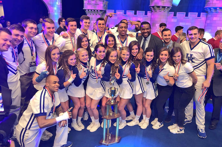 photo of 2018 UK Cheerleaders with UCA trophy