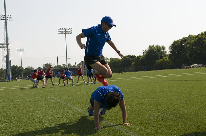 Vets and civilians participate in fitness exercises at the Johnson Center Fields