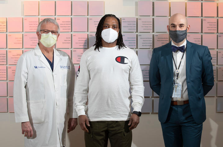 Charles Hill, center with his Doctors, David Booth, left and Andrew R. Kolodziej, right, on February 12, 2021. Photo by Mark Cornelison | UKphoto