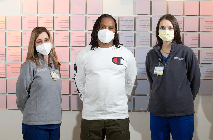 Donna Dennis, Transplant Coordinator, left,  Charles Hill, patient, center, and Cayla Hardesty, Heart Transplant Nurse Coordinator, on February 12, 2021. Photo by Mark Cornelison | UKphoto