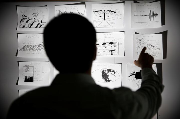 photo of Kent Ratajeski reviewing tactile graphics