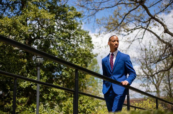 photo of Montre'ale Jones in suit standing on ramp