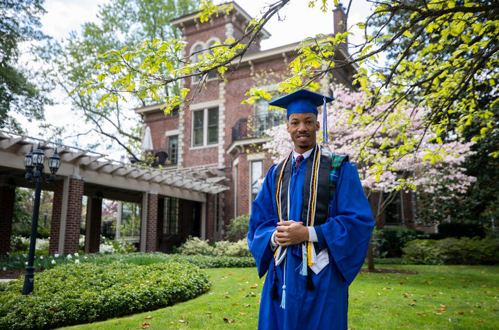 photo of Montre'ale Jones in cap and gown in front of Maxwell Place