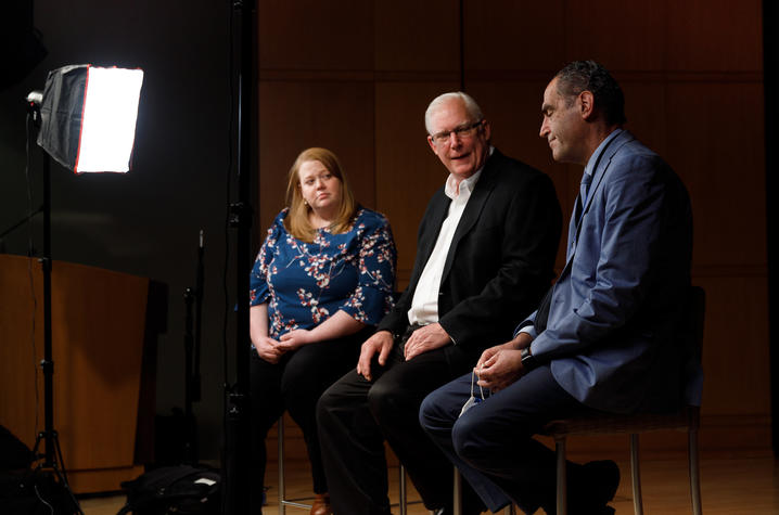 Allison Gibson, left, College of Social Work, left, Dr. Greg Jicha of Sanders-Brown , center, and Dr. Peter Sawaya, nephrology, on the set of some training videos they will be producing on April 23, 2021. Photo by Mark Cornelison | UKphoto