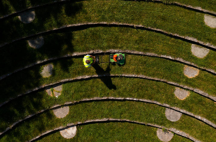 Aerial photo of two people mowing.