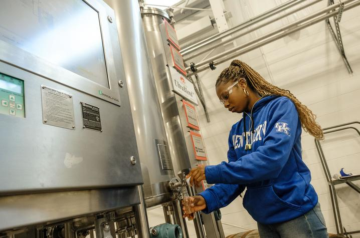 Johnna Campbell takes a sample from the blending system. Photo by Matt Barton