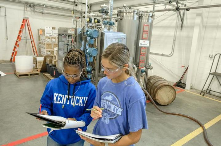 UK Distillation, Wine and Brewing Studies students Johnna Campbell and Riley Neill study their notes on the UltraBlend™ system. Photo by Matt Barton