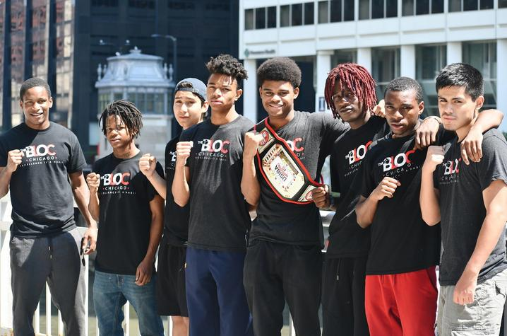 Photo of Jamyle Cannon with students from The Bloc
