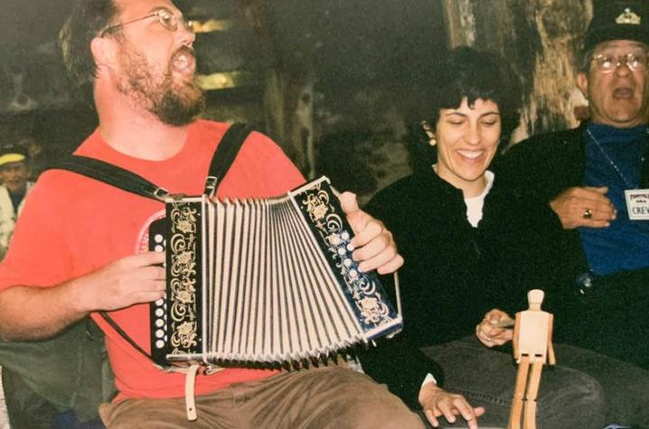 photo of Revell Carr playing accordion and singing sea chanteys