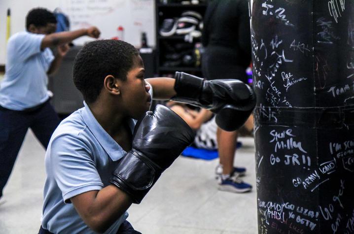 Photo of child boxing