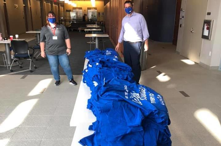 photo of Appreciation Day T-shirts from a previous year laying on a table