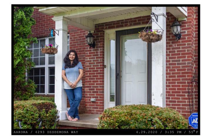 photo of Aardra Kachroo standing on front porch