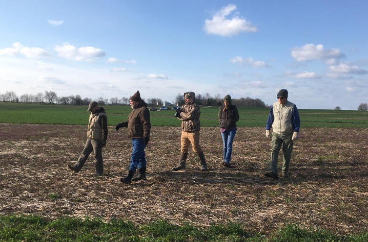 team of 5 walking on farm